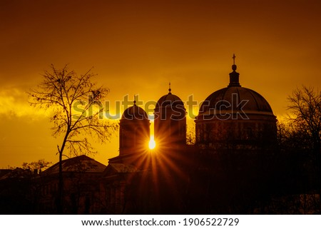 Rays of the sun at sunset make their way through the domes of Cathedral. The pro-Kafedral Catholic Cathedral of St. Alexander in Kiev. Stock photo ©