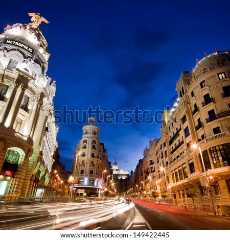 Rays of traffic lights on Gran via street, main shopping street in Madrid at night. Spain.