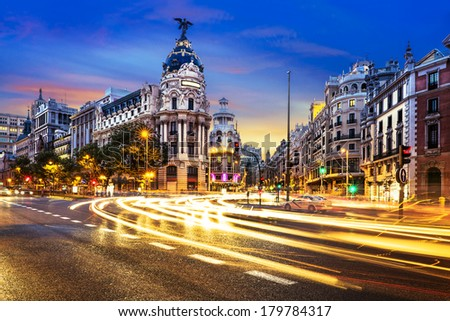 Rays of traffic lights on Gran via street main shopping street in Madrid at night Spain Europe