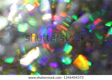 Stock Photo Rays rainbow.Blurred abstract creative background. Rainbow background. Lens flare. Colorful bokeh light. Illuminated burst of multicolor light. Lights of the night and evening city. Blurred circles.