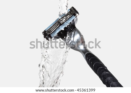 razor close-up with water splash isolated on grey-clipping path