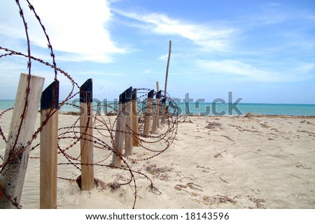 razor-wire fence on a beach