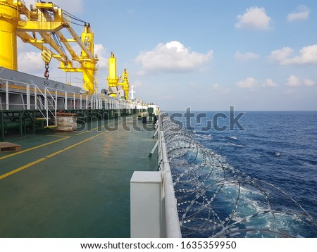 razor wire fitted on ship side during passing high risk area to prevent and avoid piracy attack. Сток-фото ©