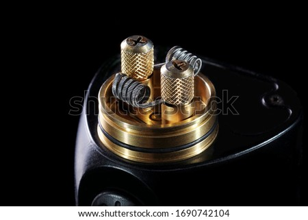 Photo of  Rda recoil for vapor isolated on black before wicking close up