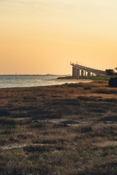 Re island bridge at sunrise on a sunny morning. beautiful colors. view from rivedoux-plage, France. portrait format