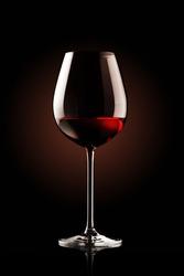 re wine glass on black background