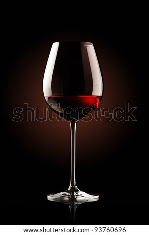 re wine glass on black background