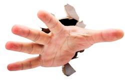 Reaching hand breaking through ripped paper.