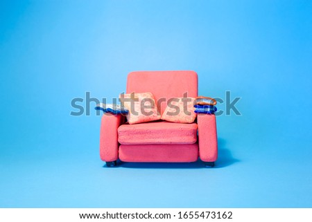 Reading a book on a sofa