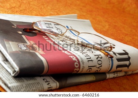 reading glasses and international newspapers