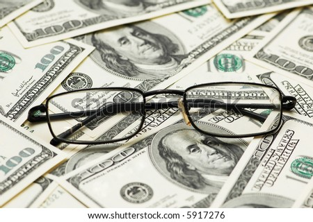 Reading glasses over the dollar bank notes - more similar photos in my portfolio - stock photo