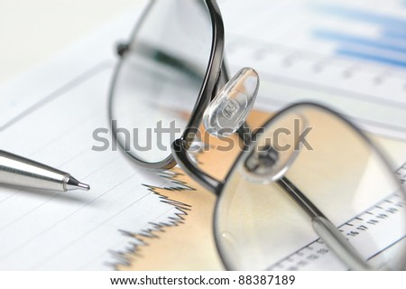 Reading Glasses, Pen and Graphs