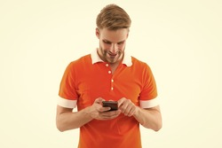 Reading incoming SMS text. Happy man read sms on smartphone isolated on white. Sms messaging. Short message service. SMS delivery confirmation. New technology. Mobile lifestyle. Modern life