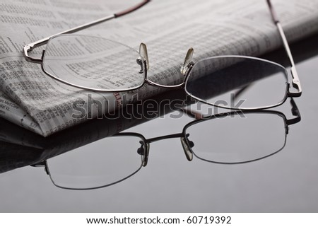 Reading newspaper and gathering stock news.