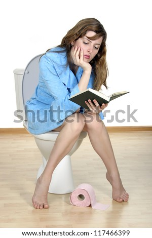 Reading on a toilet. Close up of the reading girl on a toilet.