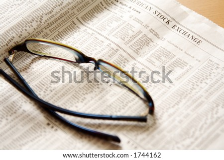 Reading stock prices on newspaper
