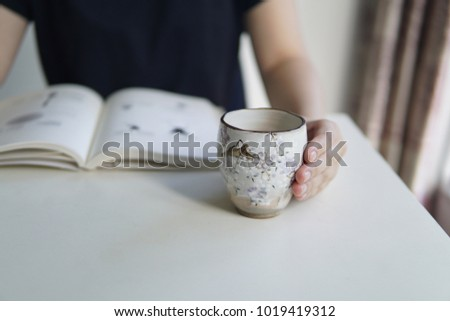 Reading tea in the afternoon #1019419312