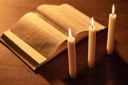 Reading the Bible by candlelight. Religious sermon. Study Of The Holy Scriptures. Christian religion. The concept of religion and faith. Protestantism, Catholicism and Orthodoxy.