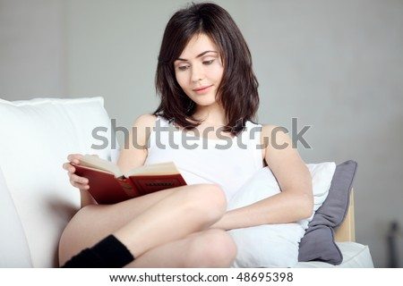 Reading the book, young beautiful girl reads book