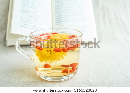 Reading time, a cup of chrysanthemum tea and books #1166528023