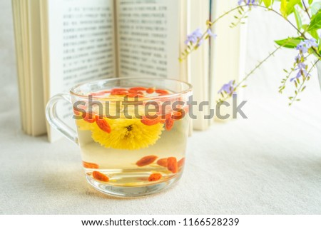 Reading time, a cup of chrysanthemum tea and books #1166528239