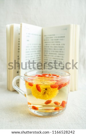 Reading time, a cup of chrysanthemum tea and books #1166528242