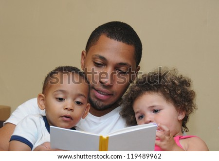 Reading Two Generation Family Father Son with dirty face and Niece Blue Eyes