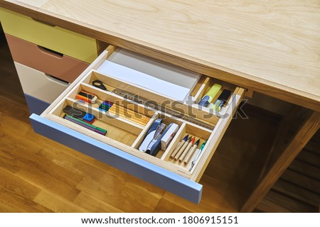 Ready for school. Open desk drawer with various school supplies arranged carefully in order before studies Foto stock ©