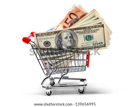 Ready for shopping - grocery cart full of cash isolated on white