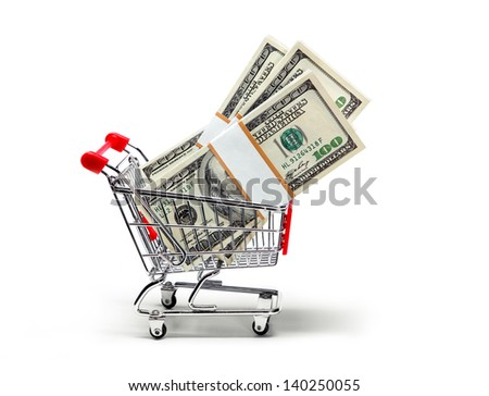 Ready for shopping - grocery cart full of stacks of dollar bills isolated on white