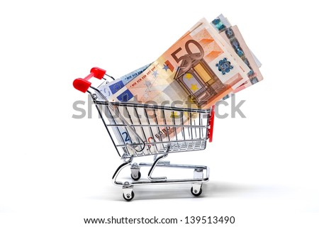 Ready for shopping - grocery cart with euro bills isolated on white