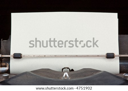 Ready for Typing - paper inserted in old dirty typewriter - blank - ready for your added words