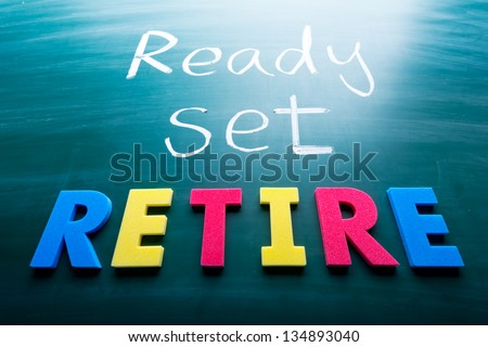Ready, set, retire! Colorful conceptual words on blackboard.