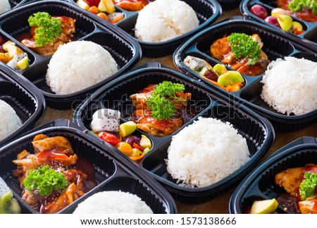 Ready to eat asian rice box, Thai food in take away plastic boxes.