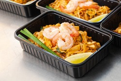 Ready to eat asian rice box, Thai food in take away plastic boxes, Pad Thai Noodles.