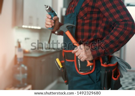 Ready to fix it. Man solves household problems
