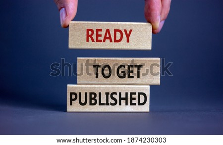 Ready to get published symbol. Wooden blocks with words 'ready to get published'. Male hand. Beautiful grey background. Copy space. Business and ready to get published concept. Сток-фото ©