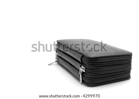Ready to go: Back To School with this black etui, isolated on a white background