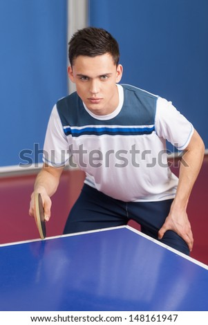 Ready to play. Confident young men getting ready to play table tennis