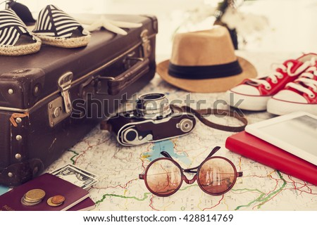 Shutterstock Ready vacation suitcase, holiday concept
