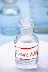 Reagent bottle with description: Sulfuric acid. a mineral acid composed of the elements sulfur, oxygen and hydrogen with the molecular formula H₂SO₄