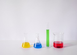Reagents Beakers. Flasks with reagents. Biological laboratory. The concept is chemistry. Laboratory equipment. Laboratory work. Beakers for experiments. Chemical analysis. Chemical reaction.