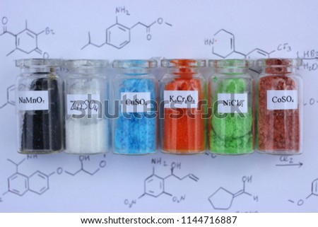 Reagents for analytical chemistry: black sodium permanganate, white zinc sulfate, blue copper sulfate, orange potassium dichromate, green nickel chloride, brown cobalt sulfate.