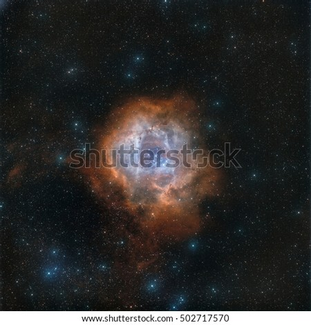 Stock Photo Real astronomical picture taken with telescope of Rosette nebula in narrowband, following hubble palette. This is an object that can be seen in winter, very close to orion constellation