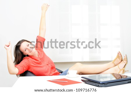 Real attractive businesswoman relaxing in her office