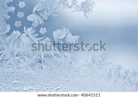 Real beautiful snowflake on the window glass