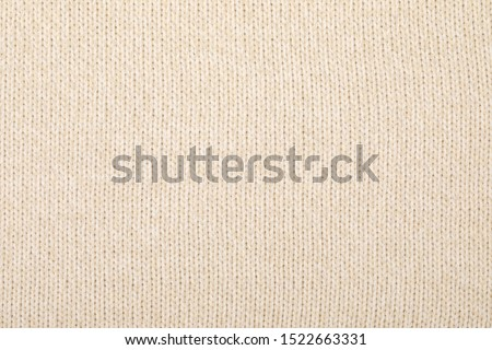 Real beige melange or ombre knitted fabric with  ornamental pattern textured background
