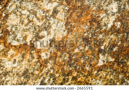 Real Brazilian granite providing rich, warm, golden earth tones and texture in high detail. Perfect for a texture or abstract background.