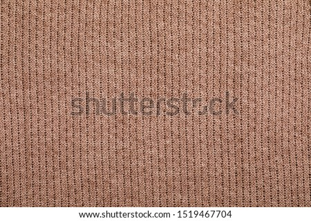 Real brown knitted fabric with  ornamental pattern textured background