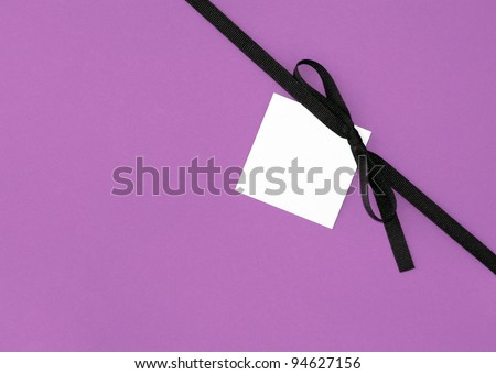 Real Brown Ribbon Bow with Blank Note card Tag on Purple / Pink background